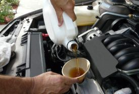 Synthetic oil and using coupons for the same
